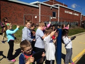 Class taking photos outside with an iPad