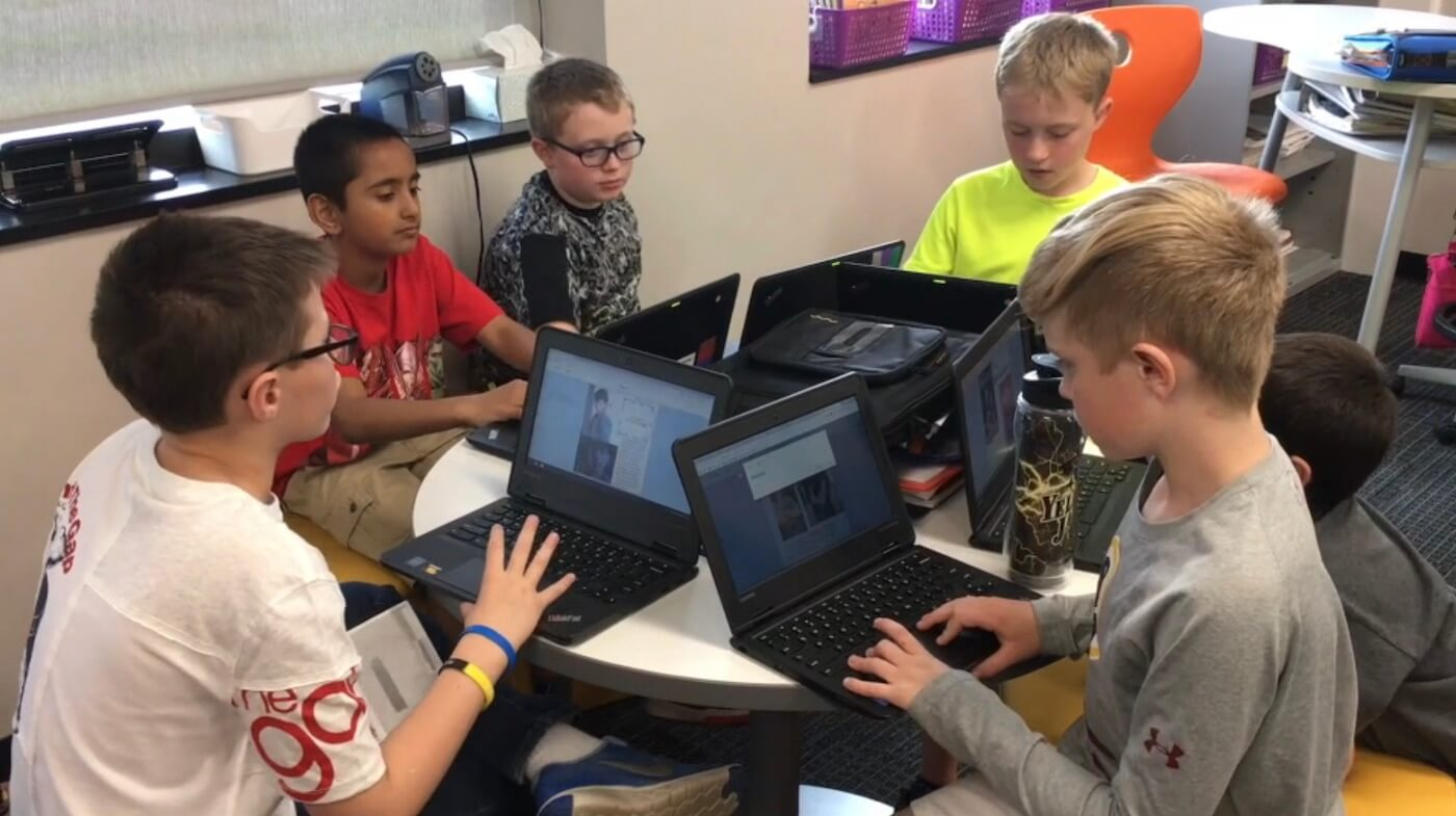 Students collaborating in a Writing Workshop